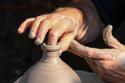 potter's hand crafting vase