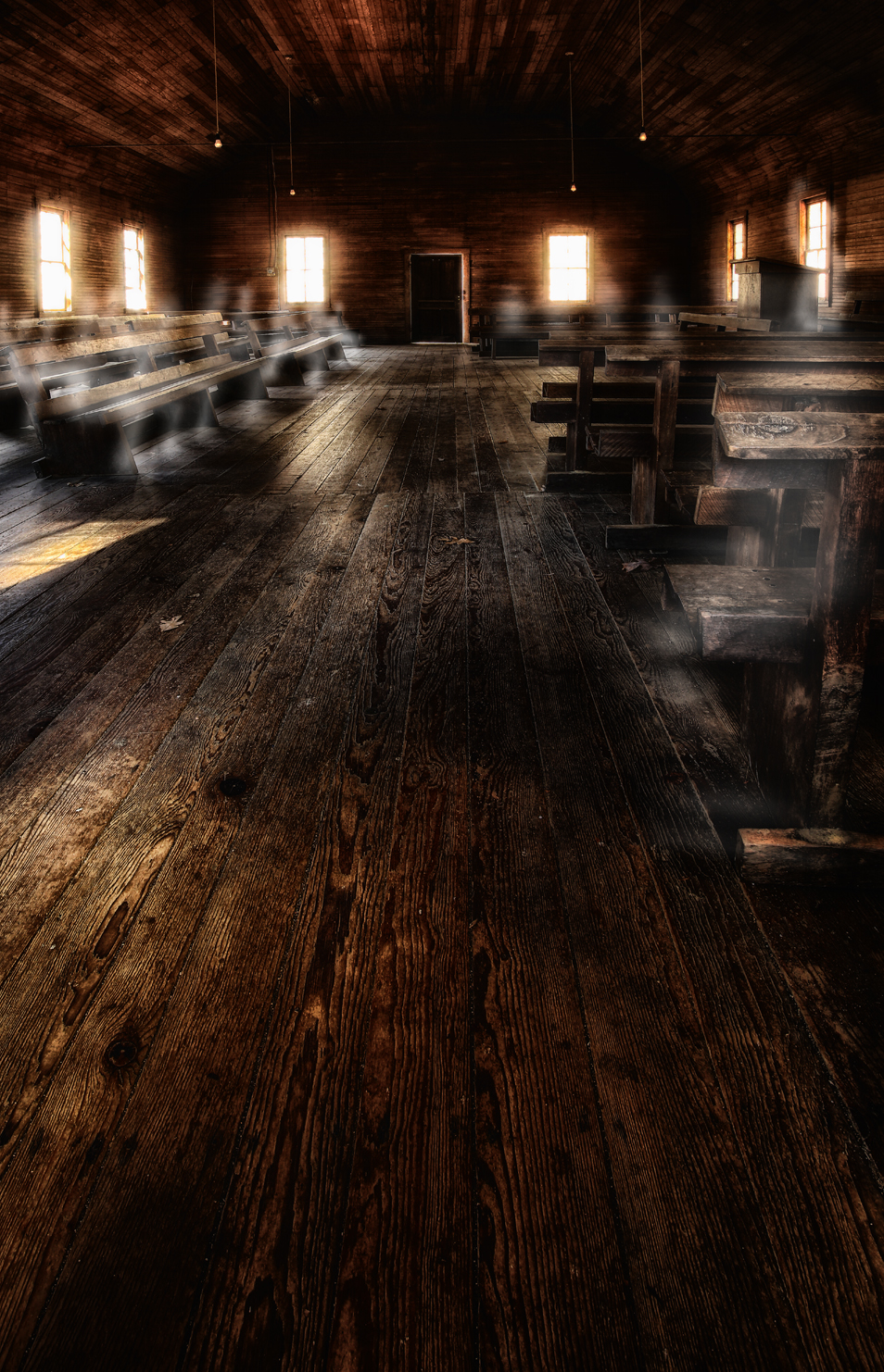 dark interior of old country church - eerie light